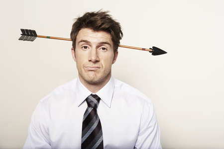 undertaking: Business man with arrow through head