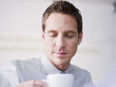 Man drinking from a cup