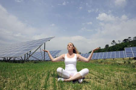 remoteness: woman doing yoga in front of solar panel