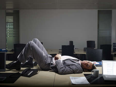 struggled: A man lies on a office table LANG_EVOIMAGES