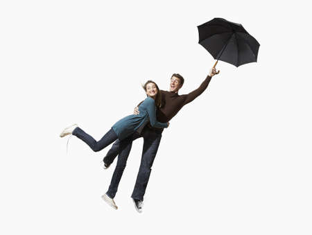 arms lifted up: Couple being blown away
