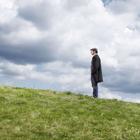 Lone man standing on hill