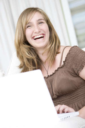 joyous: Teenage Girl on laptop computer