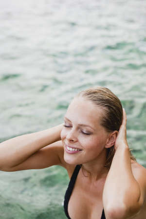 saturating: woman coming out of the water