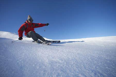 Skier turning on piste.