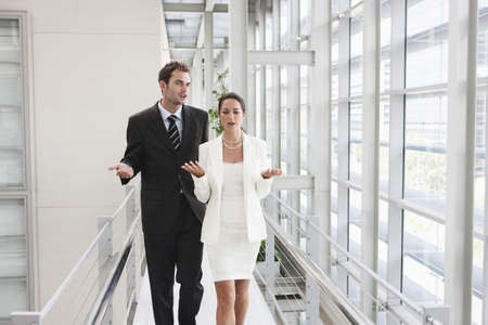 disagreed: Business couple in corridor
