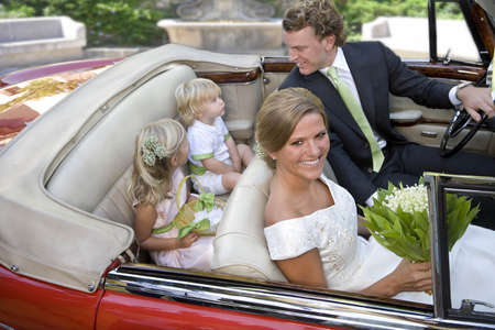 flowergirl: Wedding couple with children in car