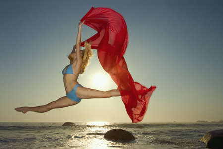 Dancer leaping on a beach LANG_EVOIMAGES