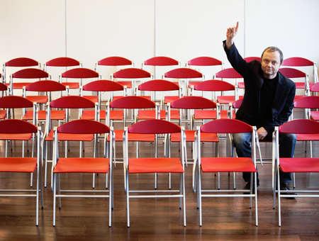 interrogations: businessman alone raising hand LANG_EVOIMAGES