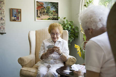 ninety's: Mature ladies playing cards together