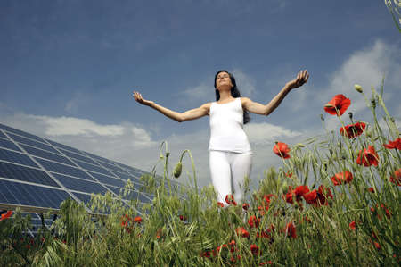 woman doing yoga in front of solar panel