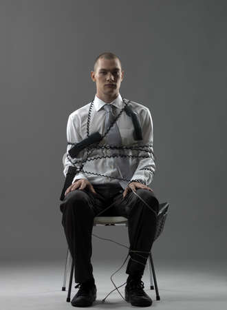 Businessman on a chair LANG_EVOIMAGES