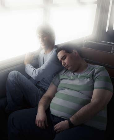 motorcoach: Thin boy squashed by fat boy