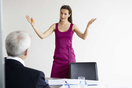 enquiring: Business woman talking with a man LANG_EVOIMAGES