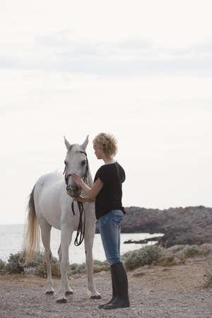 fondling: woman holding horse