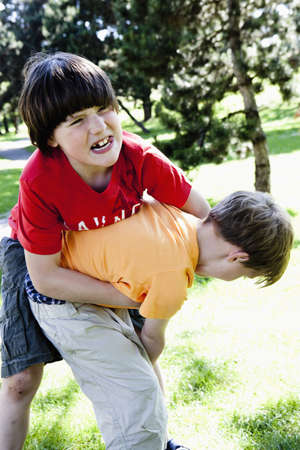 aggressively: Two Boys Grappling