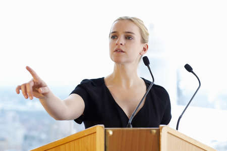 interrogations: Woman talking during a conference