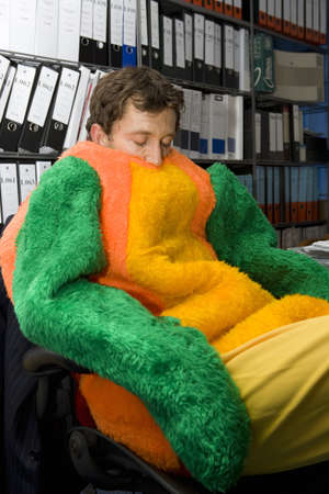 Asleep in office dressed in parrot suit