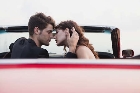 ceased: couple in car front seat kissing