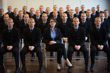 exceptionally: 1 businesswoman with 25 men clones