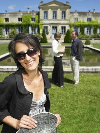 lavishly: New owner of a castle,  smiling LANG_EVOIMAGES
