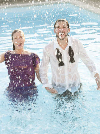 couple in swimming pool,dressed