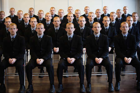 conforms: Young businessman cloned 25 times