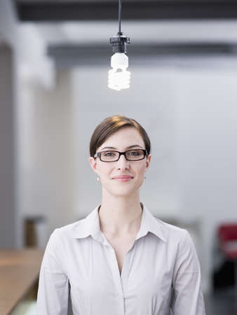 insights: Woman standing under a lamp LANG_EVOIMAGES