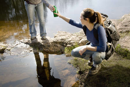 Two women with water beside lake LANG_EVOIMAGES