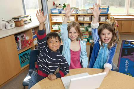 accomplishes: Students raising hands