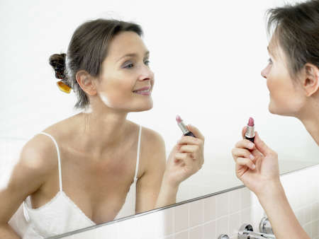 uncomplicated: Woman in bathroom, applying makeup