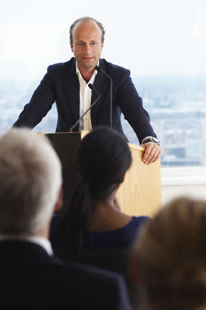 joining forces: Man talking during a conference