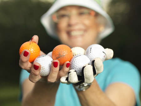 people: Mature lady with golf balls