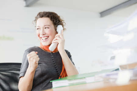 responded: Woman enjoying herself on the phone LANG_EVOIMAGES