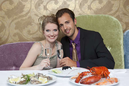 expensive: Couple drinking wine at restaurant