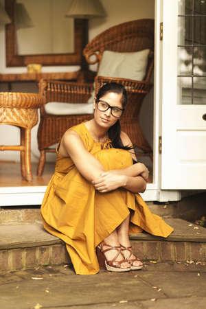 Woman sitting in courtyard