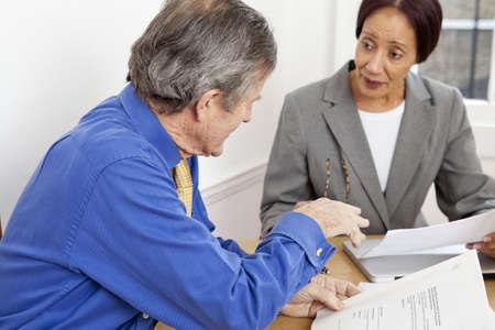 businessman pondering documents: Business people working together at desk