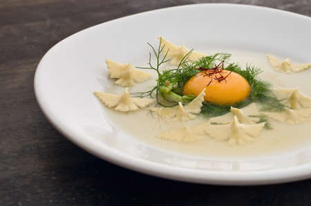 egglayer: Close up of raw egg and pasta dish LANG_EVOIMAGES