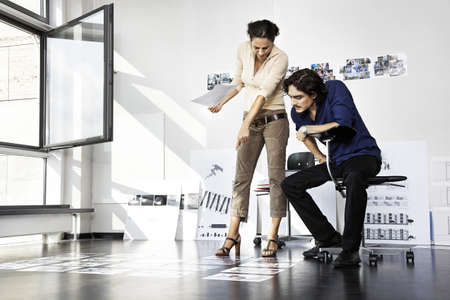 Man and woman working,architects LANG_EVOIMAGES