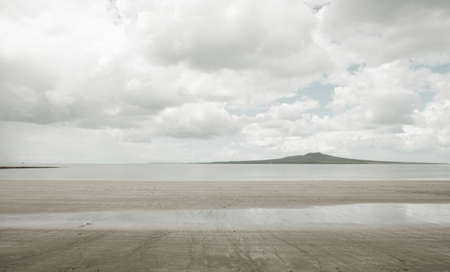 remoteness: Empty beach under cloudy sky