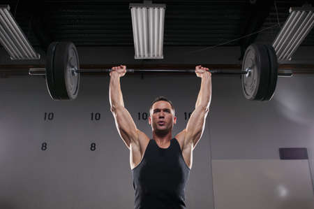struggled: Man lifting weights in gym