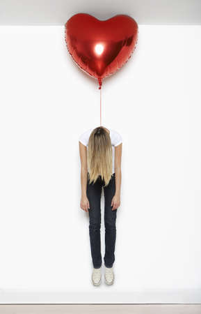 struggled: Woman lifted by heart balloon