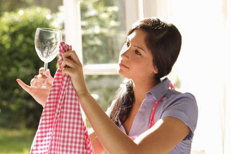 Woman carefully polishing wine glass