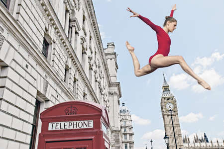 pay raise: Gymnast leaping from telephone booth