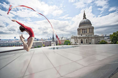 histories: Dancer with ribbon on urban rooftop