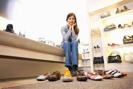 requires: Girl choosing shoes in shoe store LANG_EVOIMAGES