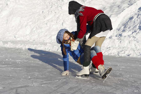 in twos: Teenage girls learning to ice-skate LANG_EVOIMAGES