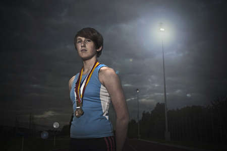 accomplishes: Female athlete with medals LANG_EVOIMAGES