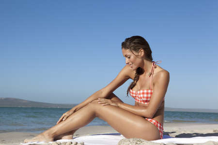 Woman relaxing in sand at beach
