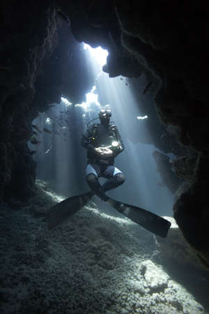 free diver: Diver in underwater cave